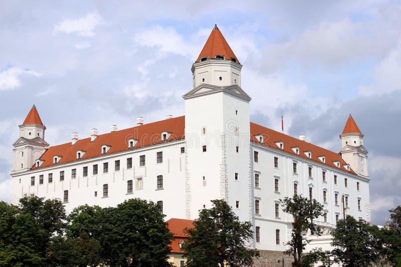 Historical white castle of Bratislava, dominating the capital of Slovakia. Under a cloudy sky stock photos