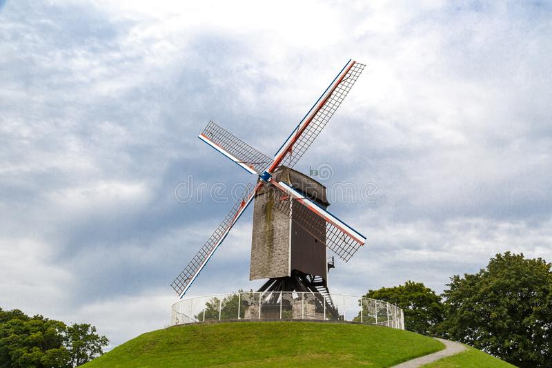 Historical Windmill in Brugge. Historical windmill on small hill in nature in Brugge, Belgium stock photos