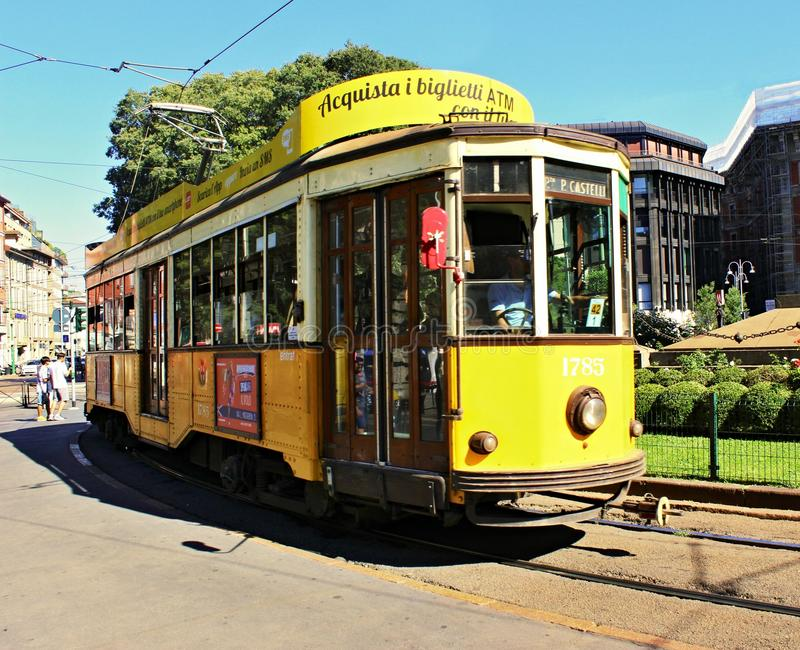 Historical yellow tram in Milan royalty free stock image