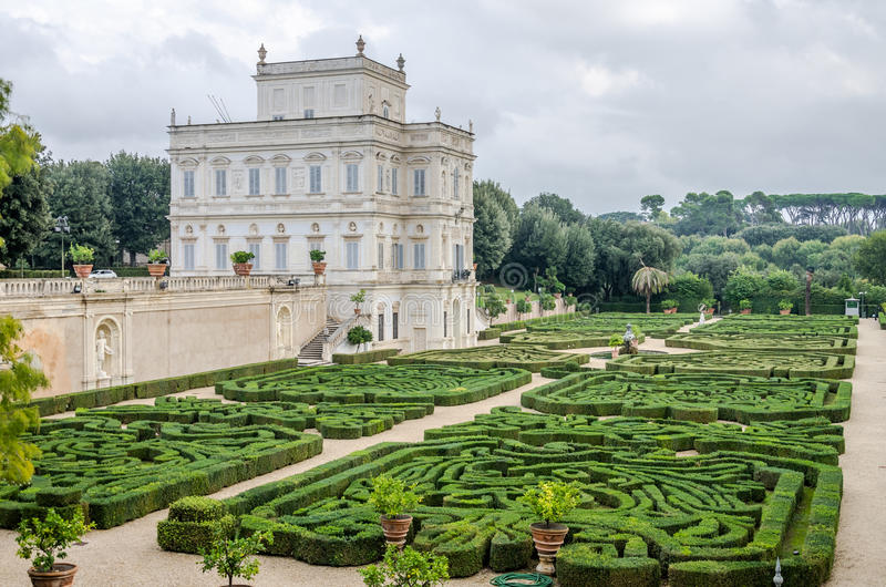 Historically, an important architectural building landmark castle with garden and flowers and shrubs ladshaftnym design in the for royalty free stock photography