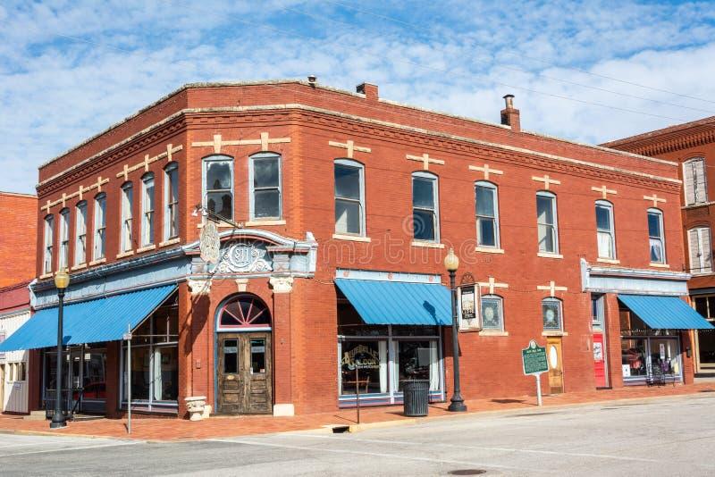 Historische Blauwe de Klokbar van de de bouwhuisvesting in O.K. Guthrie, stock foto