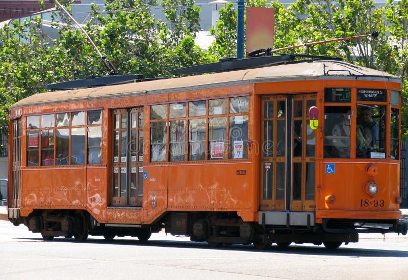 Historisches Straßen-Auto (orange) stockfoto