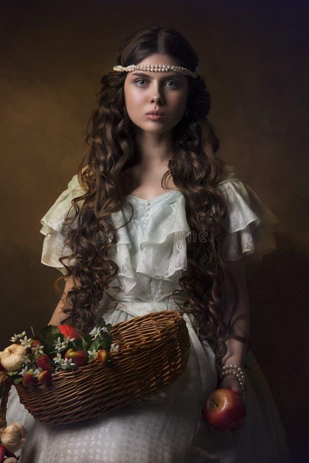 Historisk stående av en flicka med frukter royaltyfri bild