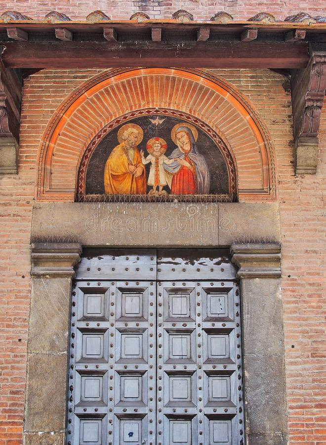 Historiska Siena Building With Religious Icon, Italien fotografering för bildbyråer