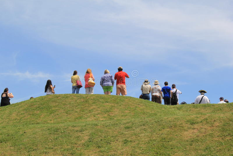 History lovers stand on grassy bluff overlooking events in the French and Indian War re-enactments, Fort Ontario, New York, 2016 stock image
