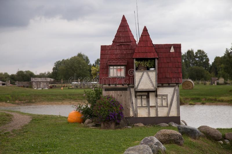 Rabit town in Latvia. The history of the rabbit town began in 2009, when Ojārs Narvils moved to Vecumnieki and built there the first Rabbit Town. In 2012 royalty free stock photo