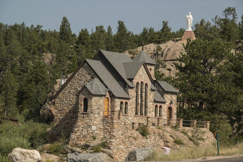Historyczna St Malo Rzymskokatolicka kaplica także dzwoni Kaplica na skale w Allenspark, Kolorado ST fotografia royalty free