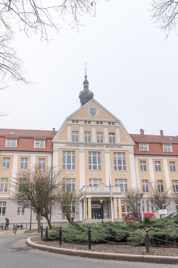 Historyczny budynek 1 Medyczny uniwersytet Gdański szpital przy dniem cloudly fotografia stock