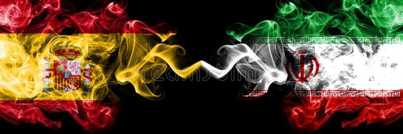 Hiszpania vs Iran, Irańskie dymiące tajemnicze flagi umieszczająca strona strona - obok - Gęsta barwiona silky dym flaga hiszpańs fotografia royalty free