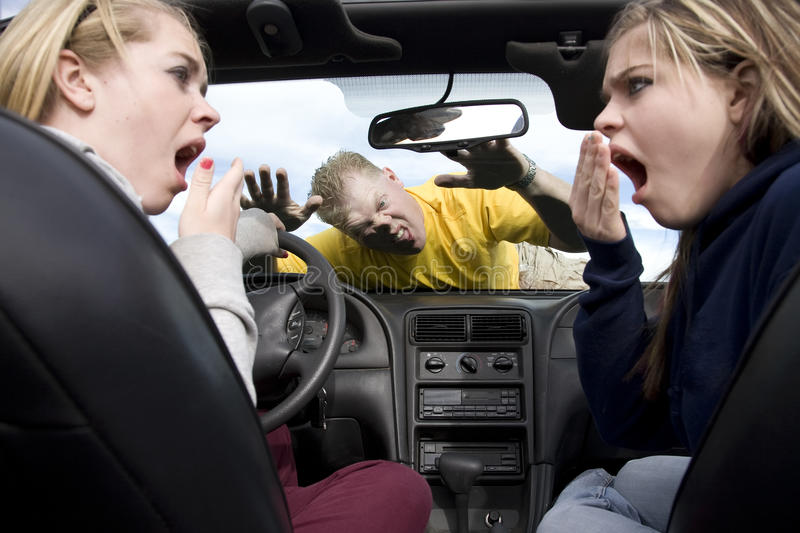 Hit man on windshield. Two teen girls in a car with shocked and scared expressions on their faces after hitting a man while they were being distracted by stock images
