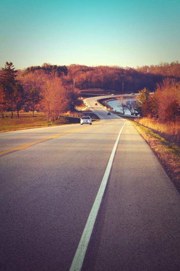 Hit the road at Lake Macbride Iowa before sunset stock image
