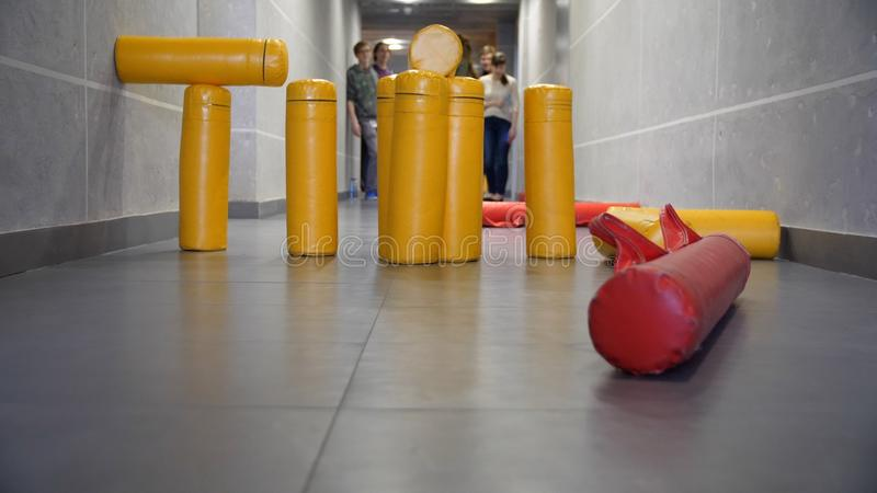 Hit of skittles game in the hall. Both casts into figure of artillery are success in streets of gorodki game stock photos