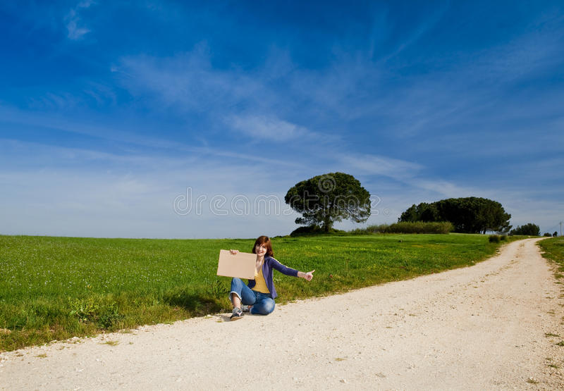Hitch hiking girl stock images