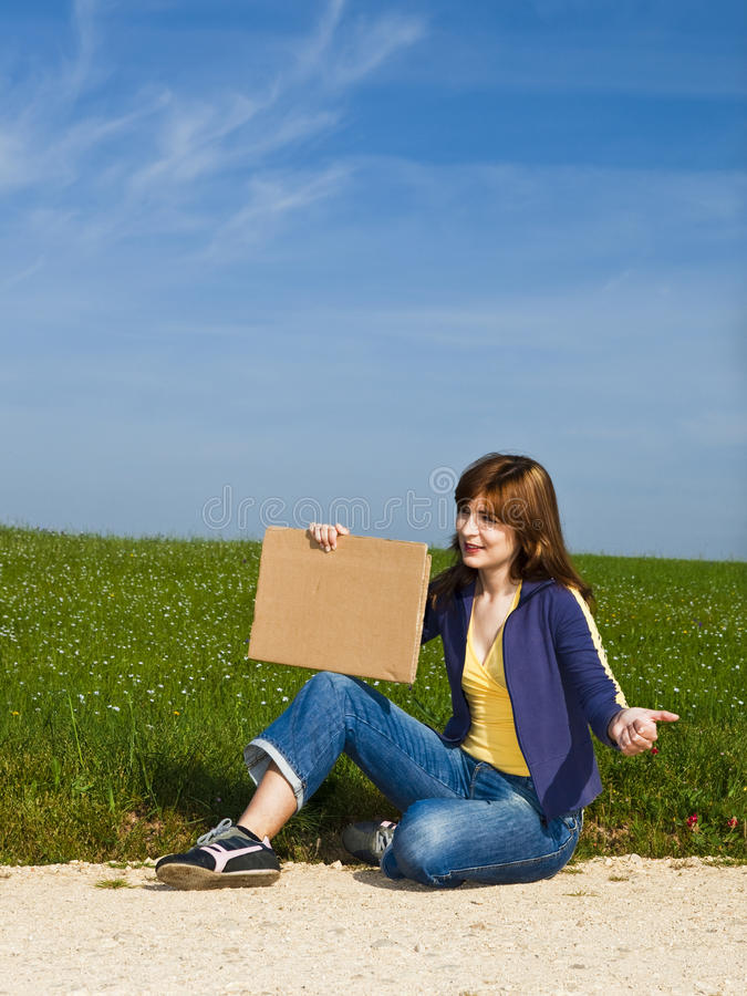 Hitch hiking girl royalty free stock image