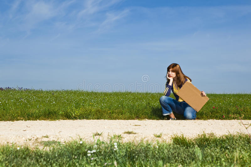 Hitch hiking girl royalty free stock photos