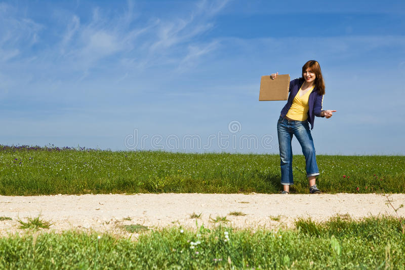 Hitch hiking girl stock photography