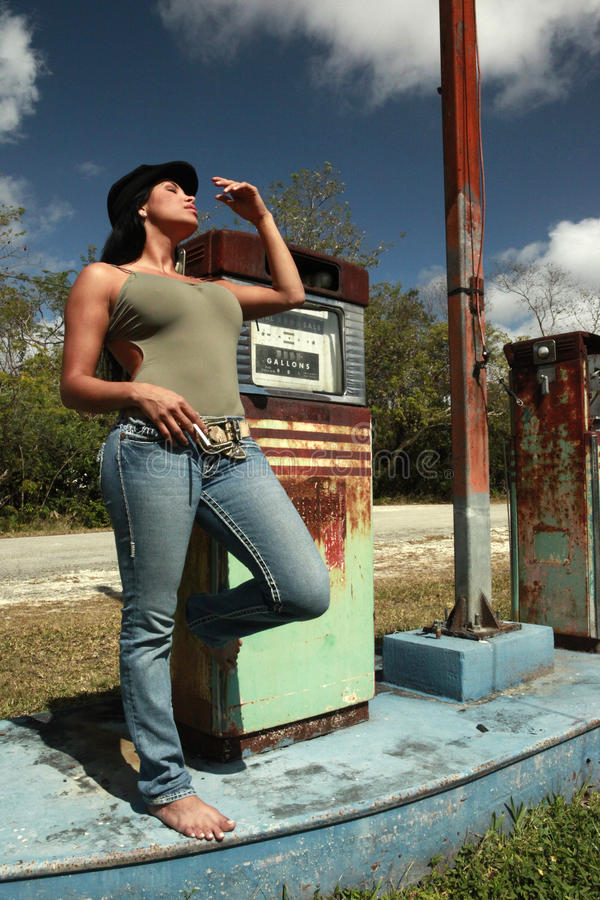 Hitchhiker At A Vintage Gas Station Stock Photo Image
