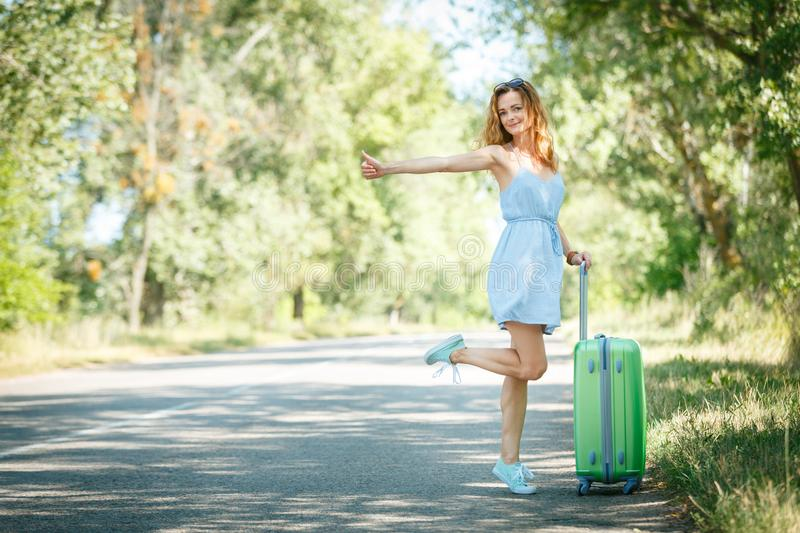 Hitchhiking girl looking for adventures royalty free stock photography
