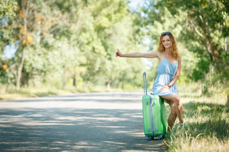 Hitchhiking girl looking for adventures stock image