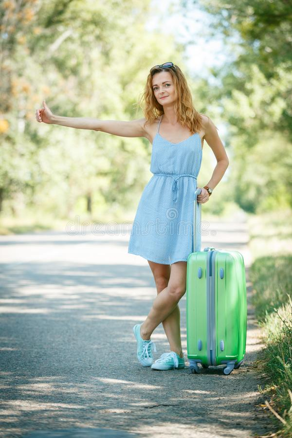 Hitchhiking girl looking for adventures royalty free stock images