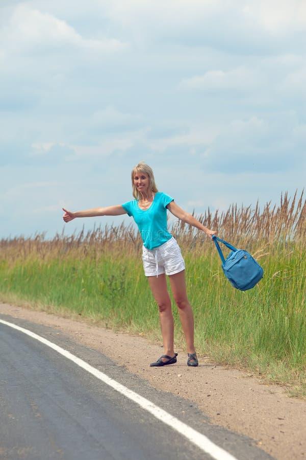 Hitchhiking Girl Votes On Road Stock Photos