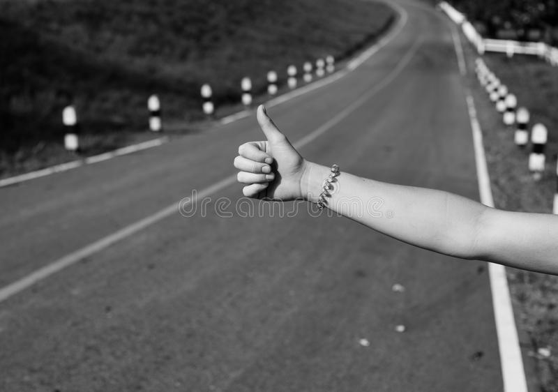 Hitchhiking Hand Sign stock images