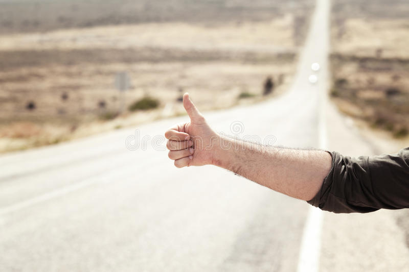 Hitchhiking. Man Hitchhiking on a Country Road stock photos