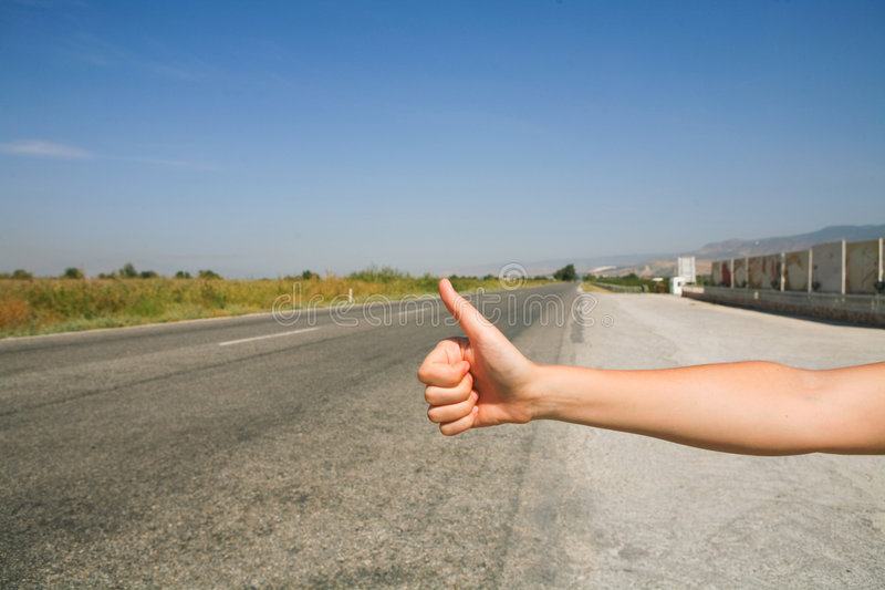 Hitchhiking the road. Hot summer day royalty free stock photos