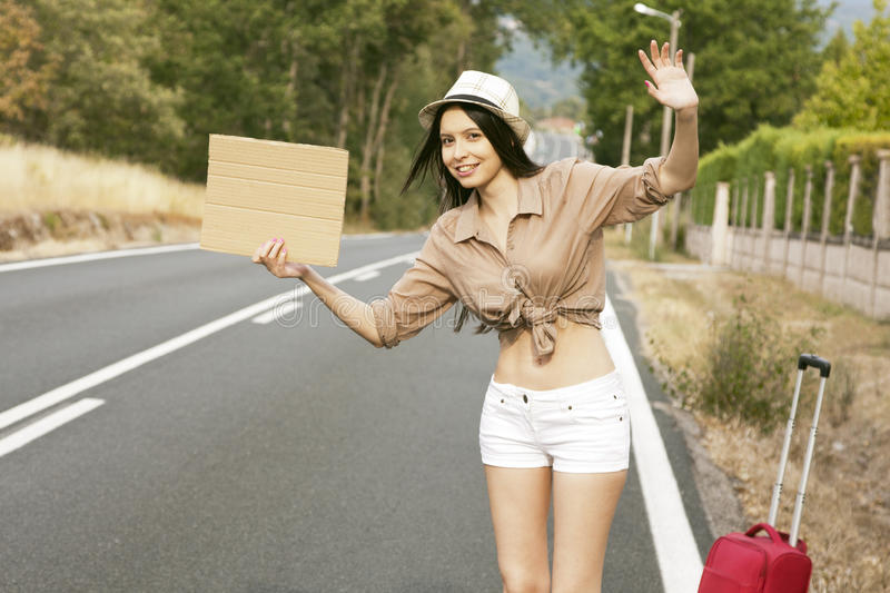 Hitchhiking on the road stock images