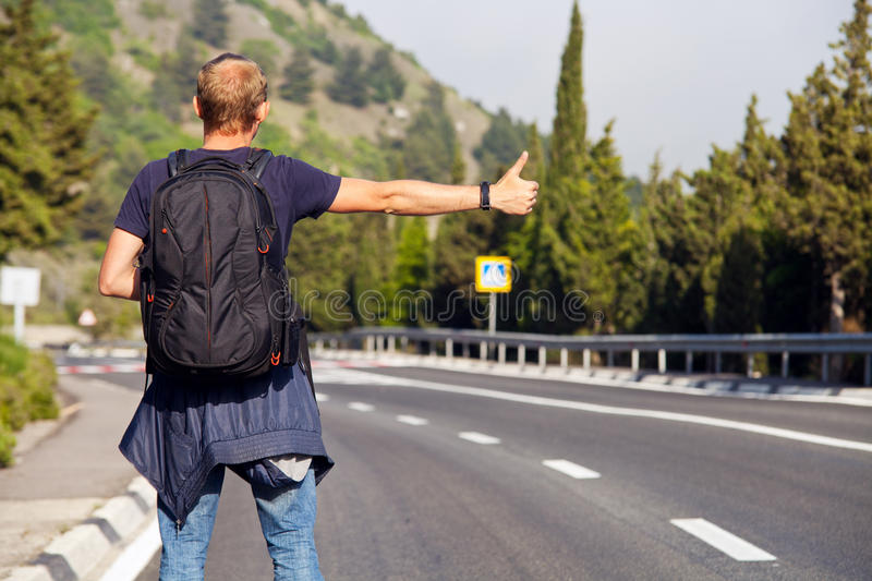 Hitchhiking travel. Man at the route royalty free stock photos
