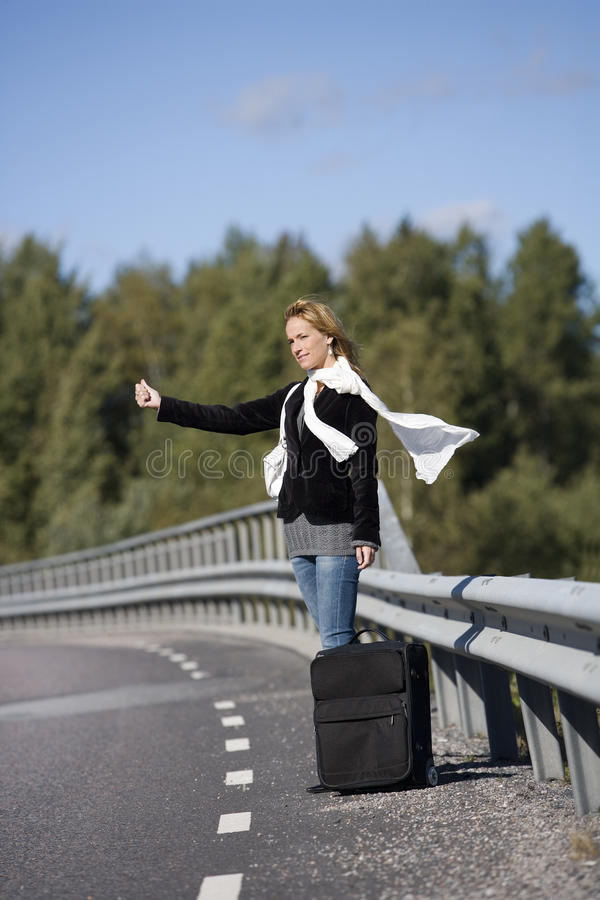 Download Hitchhiking woman stock image. Image of female, roadside - 26801605