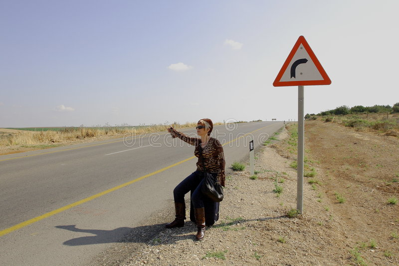 Hitchhiking woman royalty free stock images