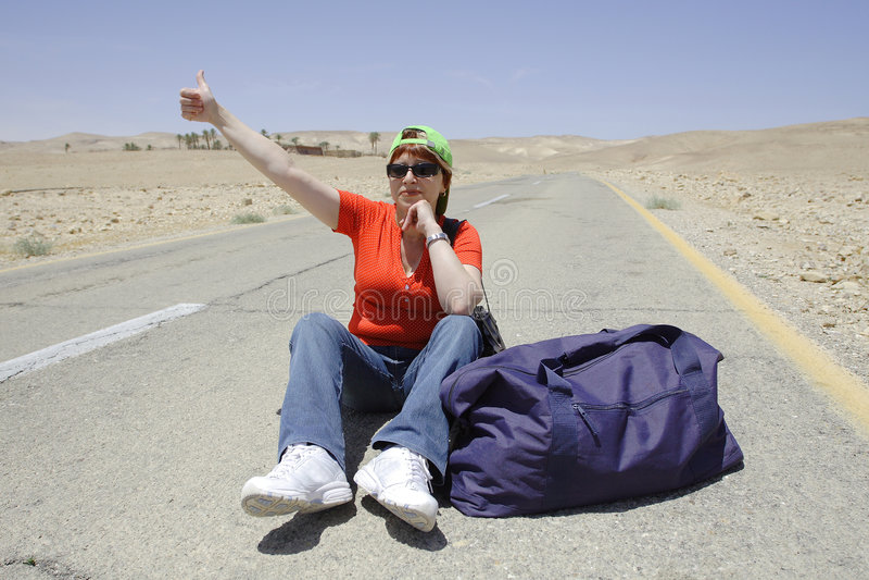 Hitchhiking woman royalty free stock photos