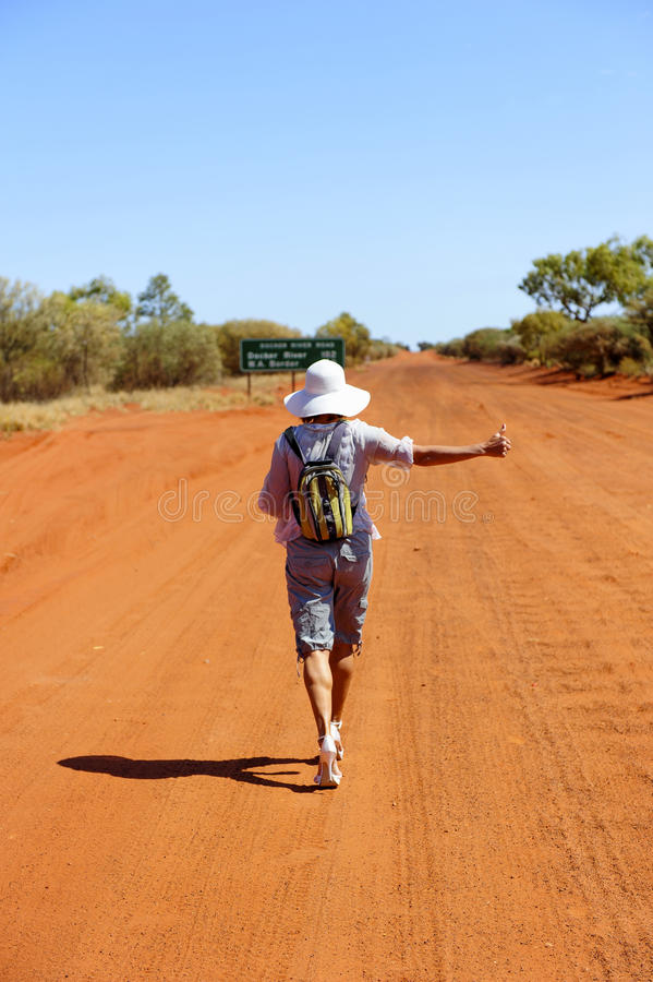 Download Hitchhiking Woman In Outback Royalty Free Stock Photography - Image: 20109317