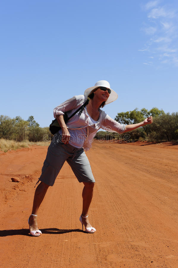 Hitchhiking Woman in Outback stock images