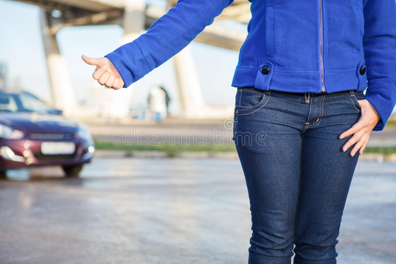 Hitching Car With Thumb Up On Roadside Royalty Free Stock Images