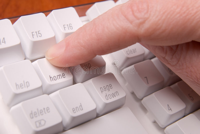 Hitting the home key royalty free stock image