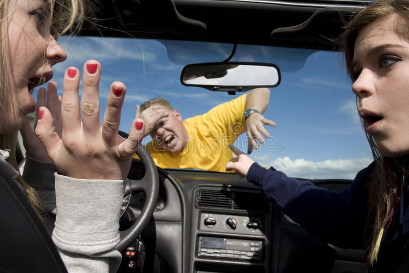 Hitting man in car. Two teen girls not knowing what to do after hitting a man because they were distracted by each other in their car royalty free stock images