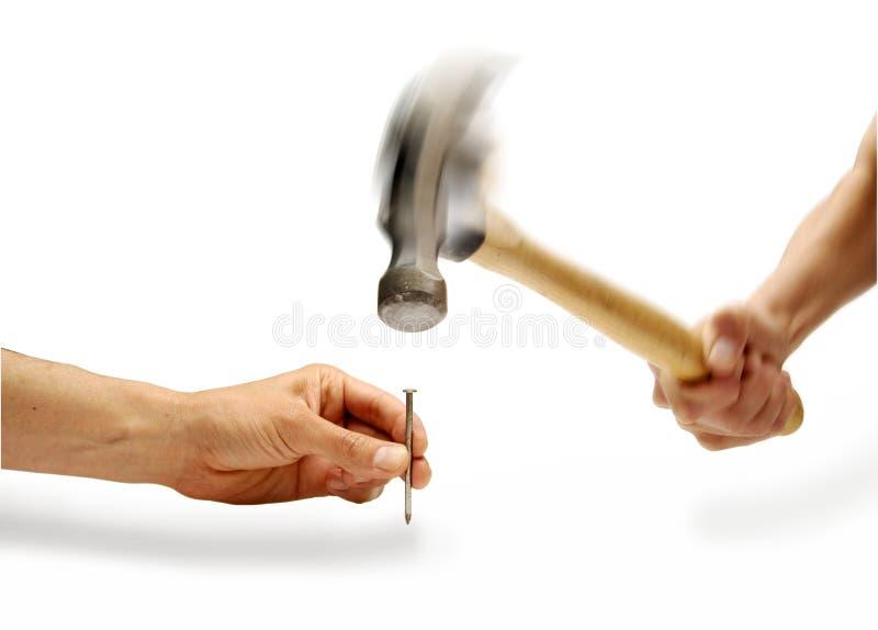 Hammer Hand Nail Holding stock photography