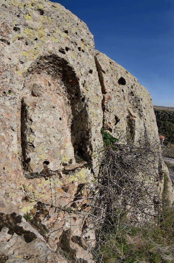 Hittites gods cut on the rock plateau,ancient religious symbols. Near ancient underground city Mazy,Cappadocia,Turkey royalty free stock image
