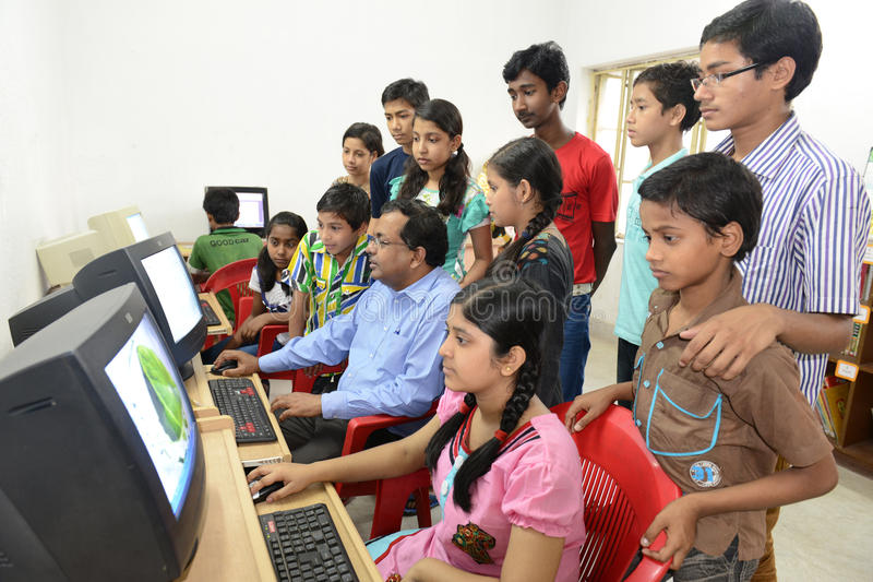 HIV Children. A group of HIV affected children learning computer with the help of a instructor at the residential center. A Kolkata based NGO has developed a royalty free stock images