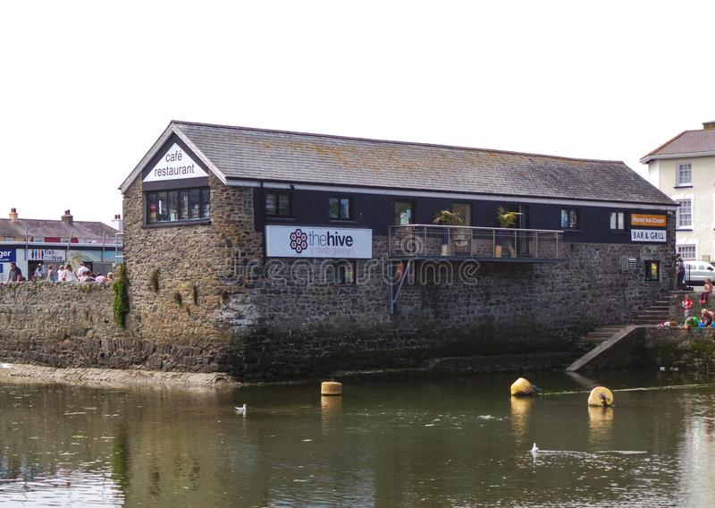 The Hive in Aberaeron. Aberaeron, United Kingdom - August 10 2013: The hive Bar and grill as viewed across Aberaeron harbour royalty free stock images