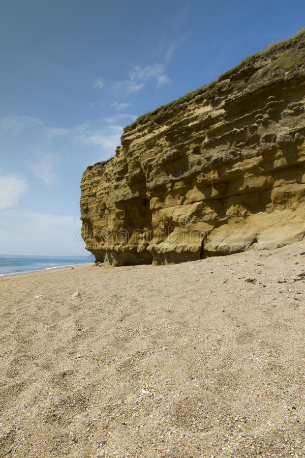 Hive Beach Cliffs. Sandstone Cliffs with pebbled beach. Hive Beach, Burton Bradstock, Bridport, Dorset, England, United Kingdom royalty free stock photo