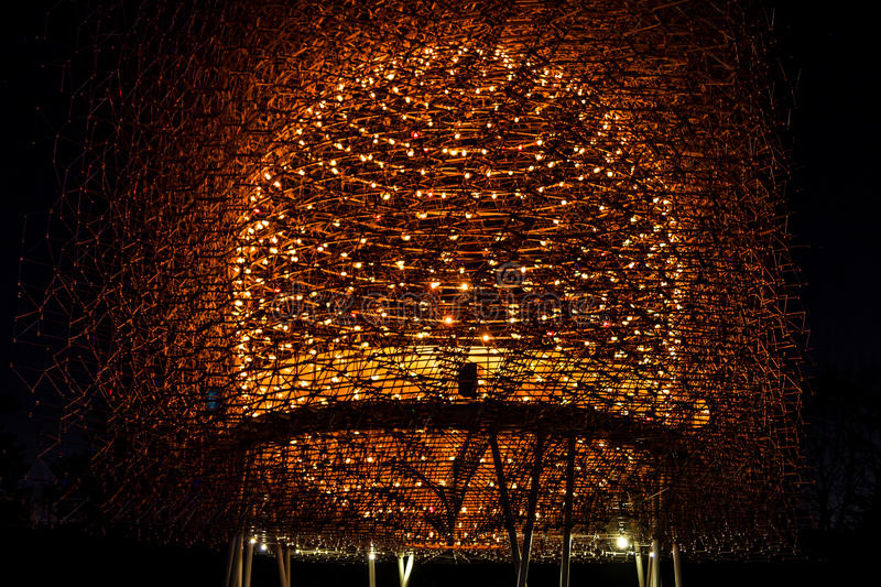 Hive of light and steel illuminated at night stock images