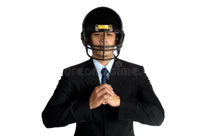 Hjälm för fotboll för amerikan för affärsman royaltyfri foto