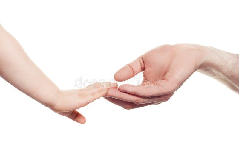hjälpa för händer Behandla som ett barn och isolerade förälderhänder arkivbilder