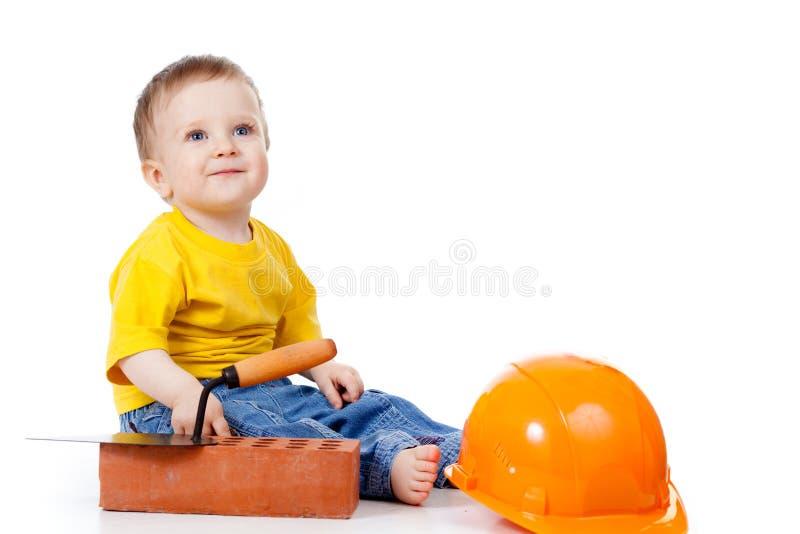 hjälpmedel för hård hatt för barnkonstruktion le arkivfoto