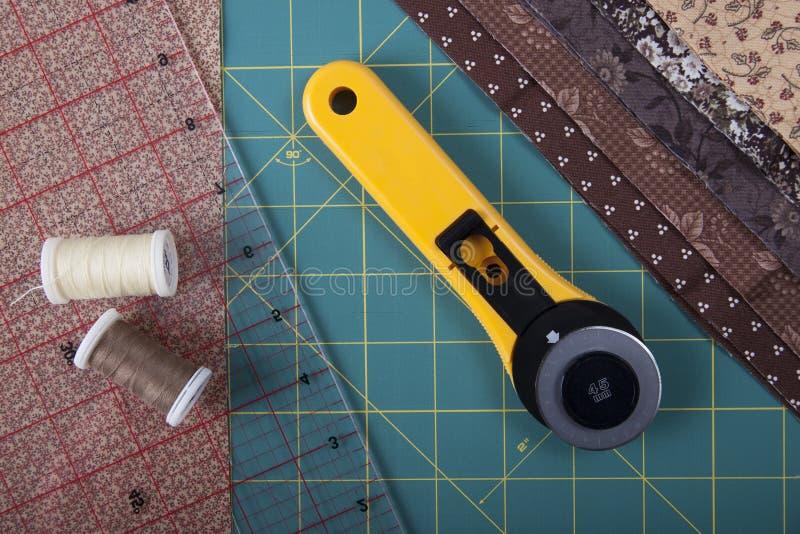 Hjälpmedel för patchworken på det mattt för patchwork royaltyfria bilder