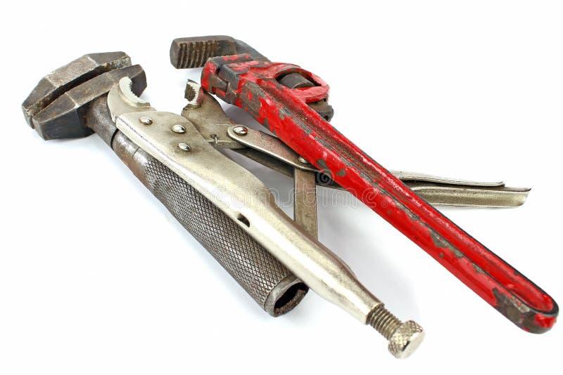Hjälpmedel (skiftnyckel, klor och rörskiftnyckel) arkivfoton