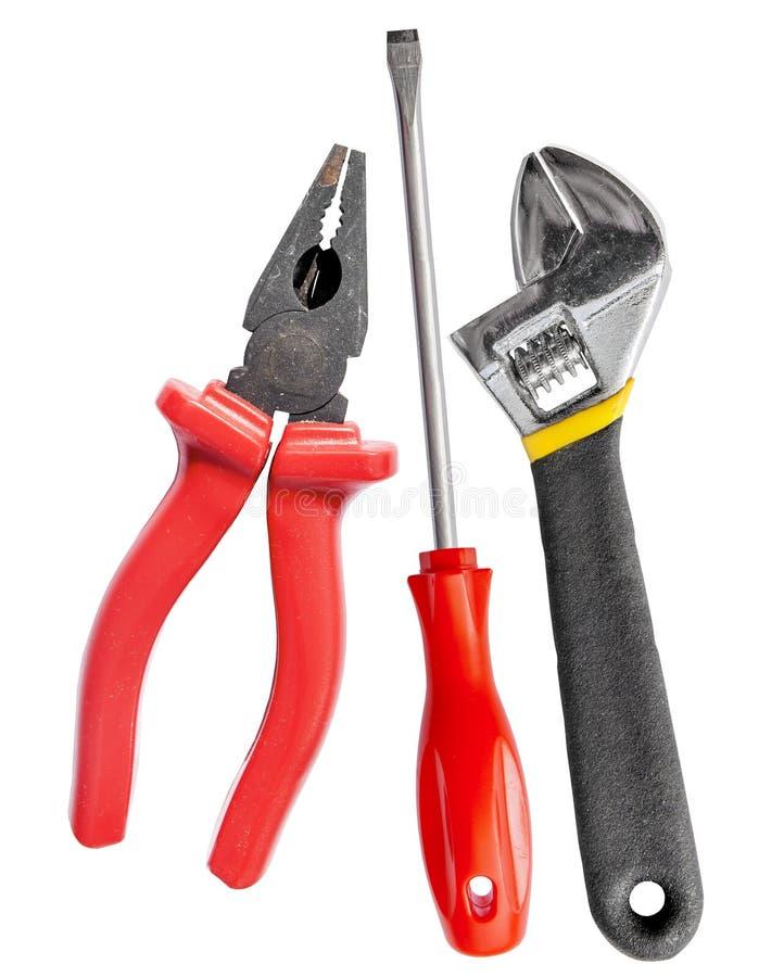 Hjälpmedeluppsättning av skiftnyckel, skiftnyckel, plattång och skruvmejsel royaltyfri fotografi